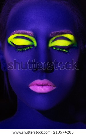 portrait of beautiful model with fluorescent make-up