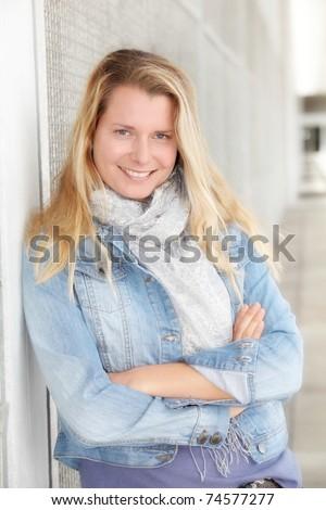 Portrait of beautiful modern woman in town - stock photo