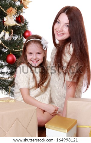 Portrait of beautiful mother and little girl having fun time on Christmas on Holiday theme/Beautiful smile woman ang lovely little girl as a familey spending freee time and enjoy it on Holiday theeme - stock photo