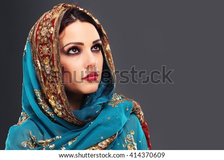 Portrait of beautiful mysterious oriental woman