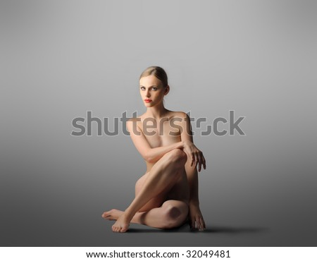 portrait of beautiful nude woman - stock photo