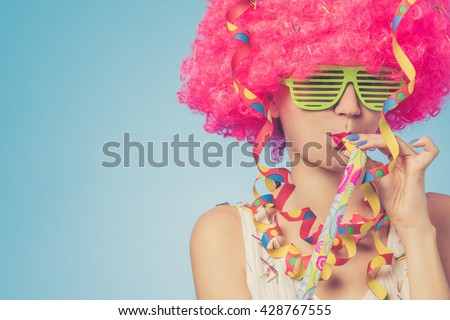 Portrait of beautiful party woman in pink wig and green glasses - stock photo