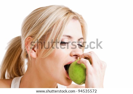 portrait of beautiful peroxide blonde with green apple girl on white