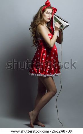 Portrait of beautiful pregnant woman in studio, pin-up style. Long red hair, perfect skin and natural make up. The concept the funny and good pregnant woman - stock photo