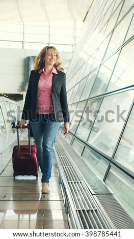 Portrait of beautiful real 35 years old woman in airport - stock photo
