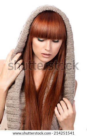 Portrait of beautiful red-haired girl with freckles wearing scarf - stock photo