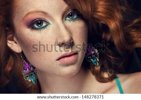 portrait of beautiful red haired girl with nice make up