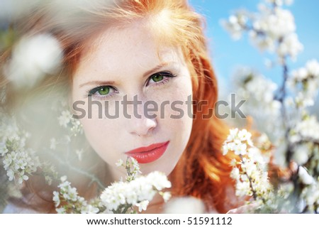 Portrait of beautiful redheaded girl in spring - stock photo