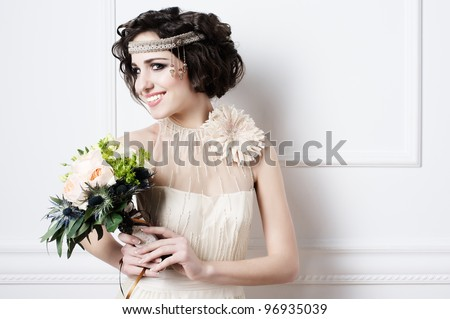 Portrait of beautiful retro bride with wedding bouquet - stock photo