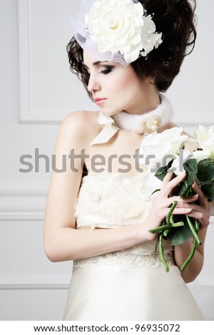 Portrait of beautiful retro bride with wedding bouquet - stock photo