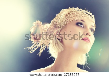 Portrait of beautiful retro-style woman in bonnet. Professional make-up, lens flares - stock photo