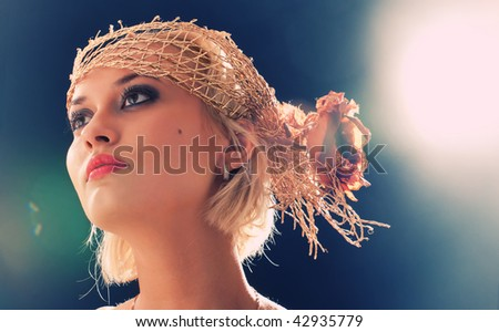 Portrait of beautiful retro-style woman in bonnet. Professional make-up, lens flares