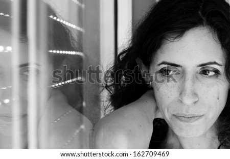 Portrait of beautiful sad 35 years old woman - stock photo