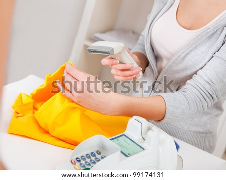 Portrait of beautiful sales person in the retail store - stock photo