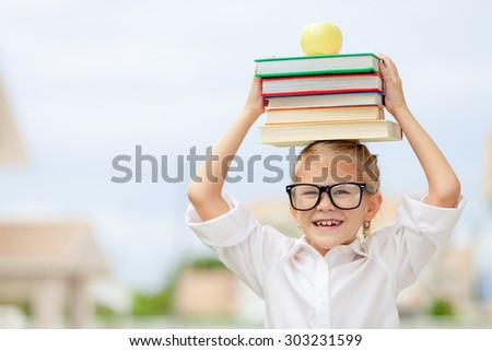 Portrait of Beautiful school girl looking very happy outdoors at the day time. Concept school theme. - stock photo