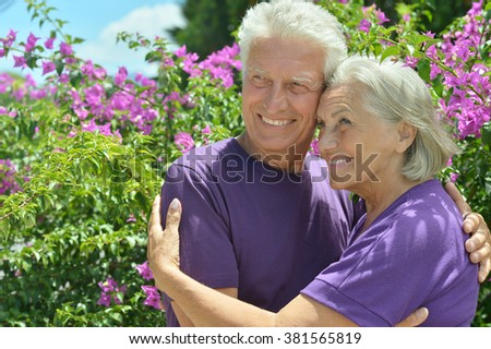 Portrait of beautiful senior couple outdoor in summer park - stock photo