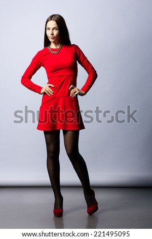 Portrait of Beautiful Sensual Woman in Fashion Red Dress.  - stock photo