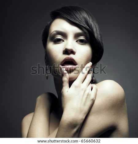 Portrait of beautiful sensual woman with elegant hairstyle - stock photo