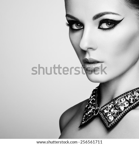 Portrait of beautiful sensual woman with elegant hairstyle. Diamond collar. Perfect makeup. Fashion photo. Black and White - stock photo