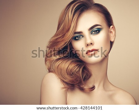 Portrait of beautiful sensual woman with elegant hairstyle. Perfect makeup. Beauty fashion. Eyelashes. Lips. Cosmetic Eyeshadow - stock photo
