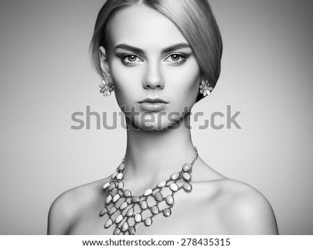 Portrait of beautiful sensual woman with elegant hairstyle.  Perfect makeup. Blonde girl. Fashion photo. Jewelry. Black and white - stock photo