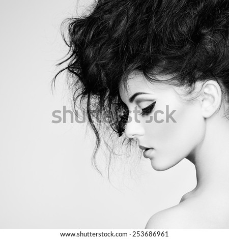 Portrait of beautiful sensual woman with elegant hairstyle.  Perfect makeup. Fashion photo - stock photo