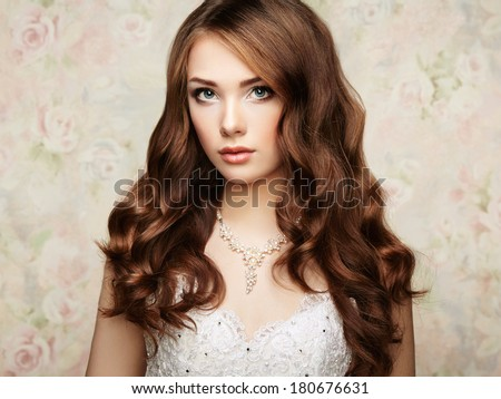 Portrait of beautiful sensual woman with elegant hairstyle. Wedding dress. Fashion photo - stock photo