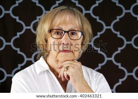 Portrait of beautiful serious senior woman - stock photo