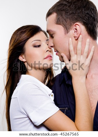 Portrait of beautiful sexual couple posing at studio