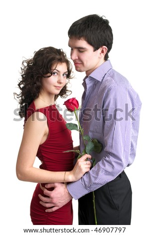 Portrait of beautiful sexual couple with red rose over white - stock photo