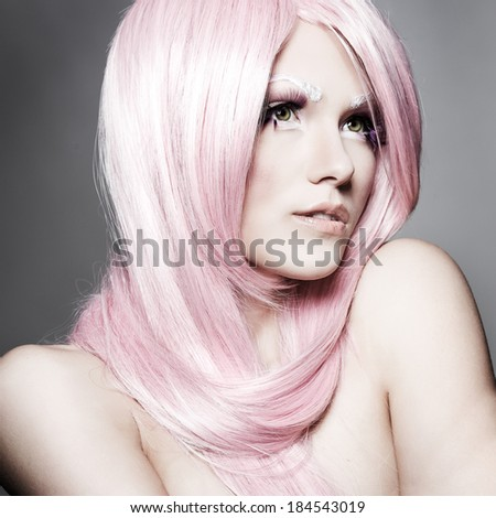 portrait of beautiful sexual girl in a pink wig