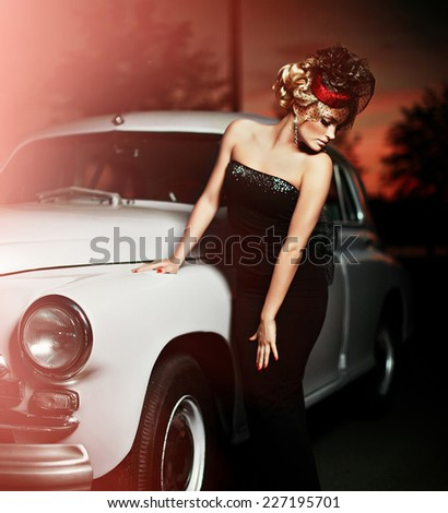 Portrait of beautiful sexy fashion stylish blond girl model with bright makeup in retro style near old car - stock photo