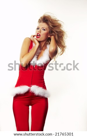 Portrait of beautiful sexy girl wearing santa claus clothes on white - stock photo