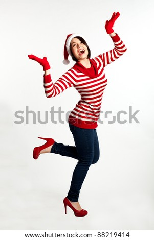 Portrait of beautiful sexy girl wearing Santa clothes. Isolated on white background. - stock photo