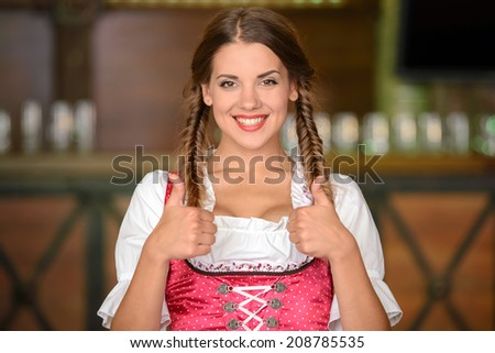 Portrait of beautiful sexy woman waiter in a pub beer - stock photo
