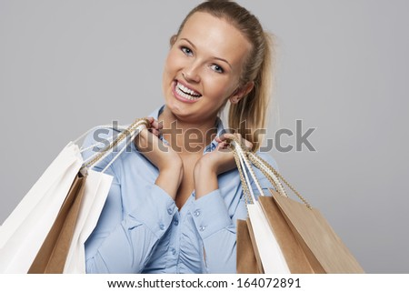 Portrait of beautiful shopaholic with shopping bags