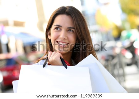 Portrait of beautiful shopping girl holding bags - stock photo