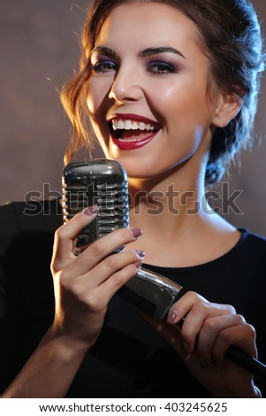 Portrait of beautiful singing woman, close up