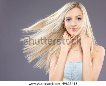 portrait of beautiful slavonic blonde girl with fluttering hair