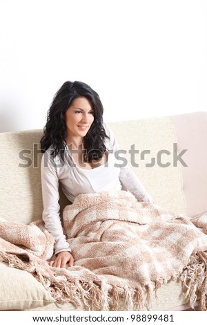 Portrait of beautiful sleepe woman sitting on sofa - stock photo