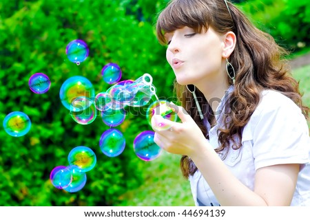 portrait of beautiful smile teen with soap bubbles