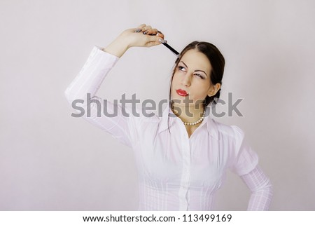 portrait of beautiful smiling businesswoman with pen at office - stock photo