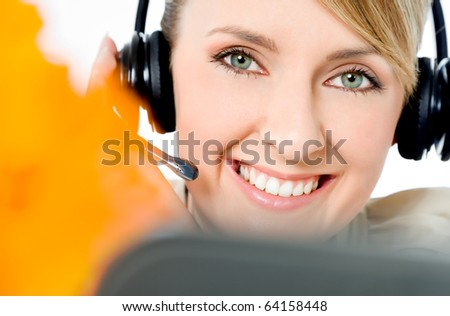 Portrait of beautiful smiling call center woman, looking at camera - stock photo