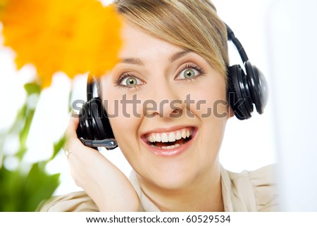Portrait of  beautiful smiling excited call center woman with headset - stock photo