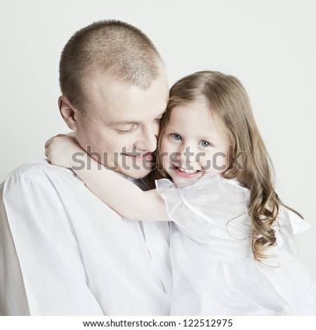 Portrait of beautiful smiling family: father and daughter on a white background