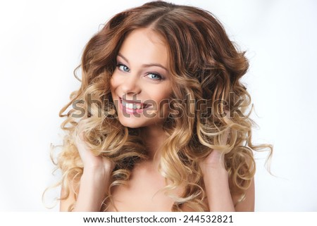 Portrait of beautiful smiling girl with luxuriant hair curling. Health and Beauty. - stock photo