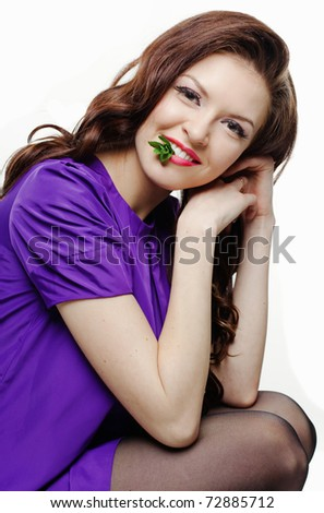 Portrait of beautiful smiling girl with peppermint against white background - stock photo