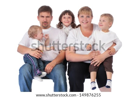 Portrait of beautiful smiling happy family of five - isolated over a white background - stock photo