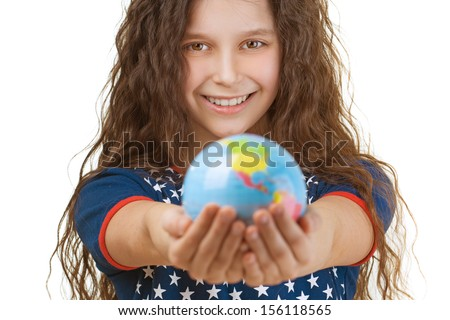 Portrait of beautiful smiling little girl with globe, isolated on white background.