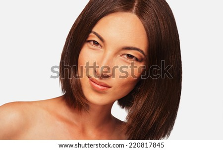 Portrait of beautiful smiling mixed race woman on white background